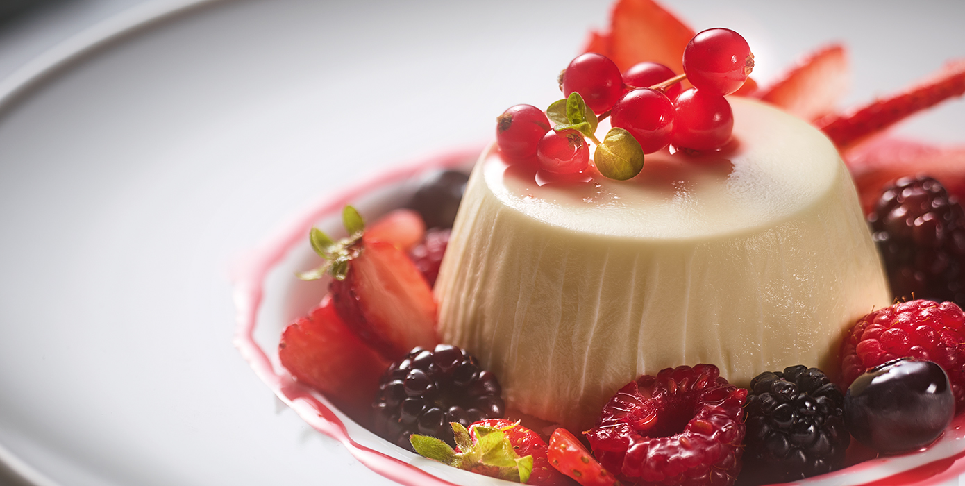 Panna Cotta with wild berries with raspberry coulis