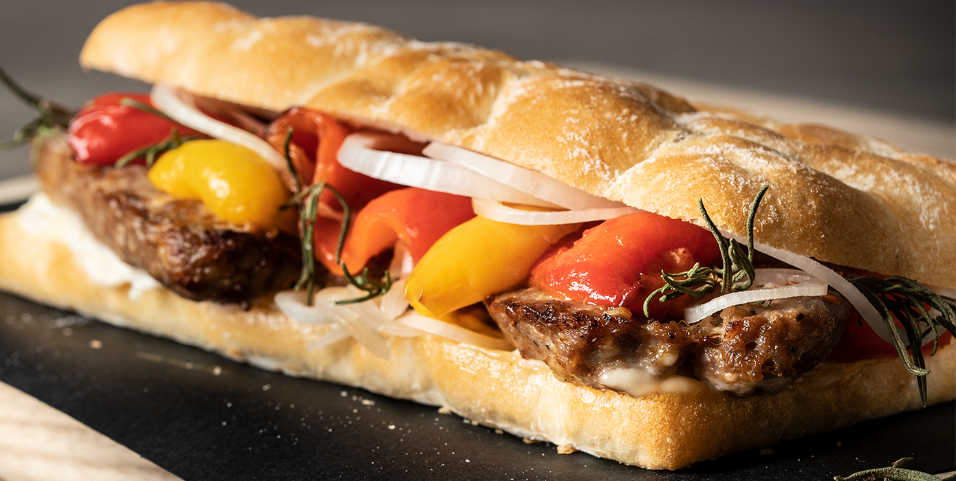 Schiacciata with sausage and capsicum peppers
